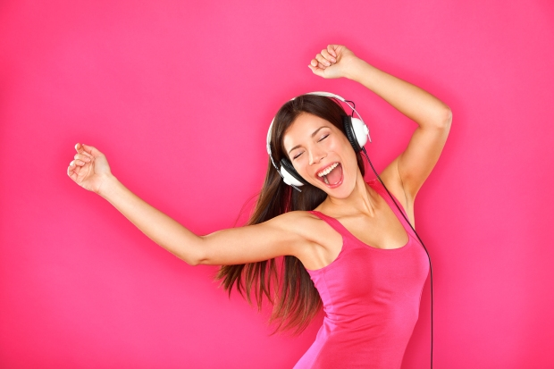 bigstock-Woman-Dancing-Listening-To-Mus-37734310